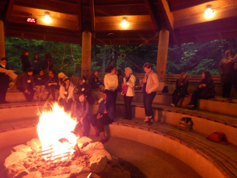 Photo: discussion around lit firepit