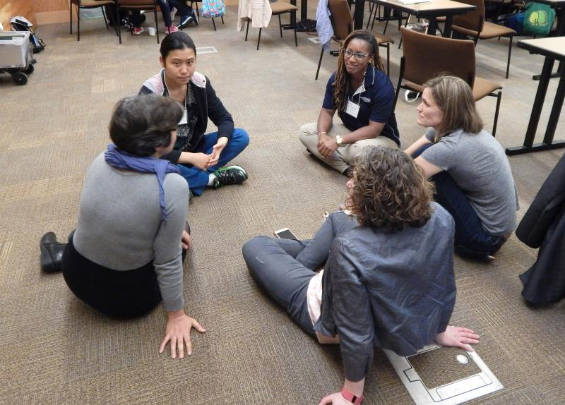 Photo: small group discussion on the floor